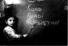 Kurdish girl at black board