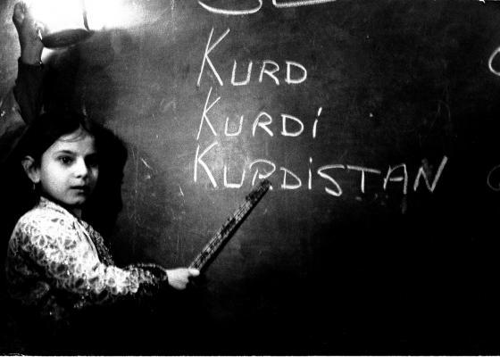 Kurdish girl at black board